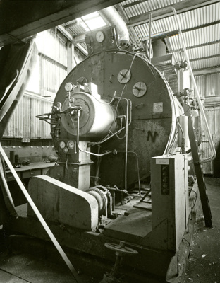 Black and white photograph of the boiler at the de...
