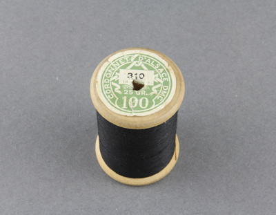Sewing thread on wooden spool; black D.M.C brand c...