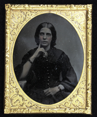 An ambrotype portrait of a young woman which is mo...
