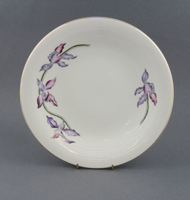 Plate; a single plate, white with orchid decals an...