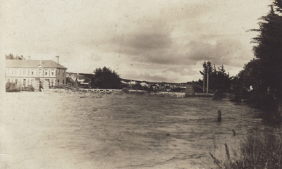 Black and white postcard showing the Mataura River...
