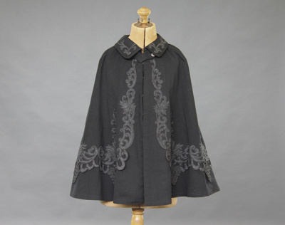 Cape; a women's black, woollen cape, appliquéd wi...
