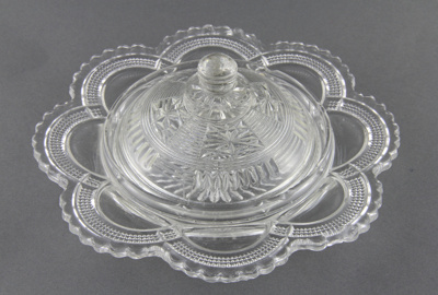 Glass dish and dome cover; a clear-patterned heavy...