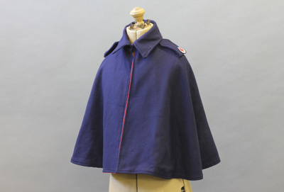 Cape; a woollen navy blue Red Cross uniform cape w...