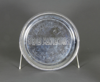 Tray; a round presentation tray embossed with: 'T....