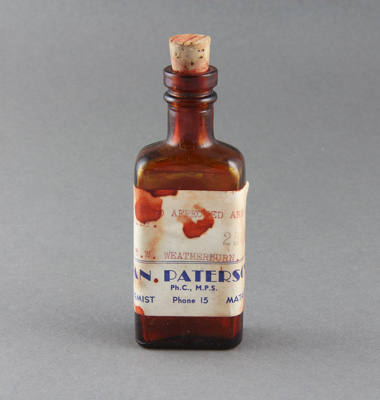 Medicine bottle; a red brown medicine bottle with ...