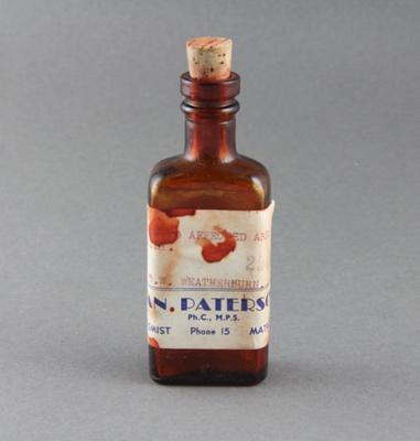 Medicine bottle; a red brown medicine bottle with ...