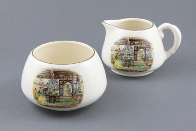 Sugar Basin and Cream Jug; a stacked sugar basin a...