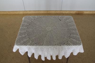 Shawl; a hand crocheted circular white woollen bab...
