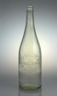 Bottle; a clear glass bottle used for bottling cor...