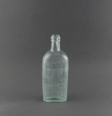 Bottle; a clear glass bottle, used for bottling ma...