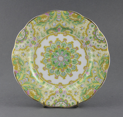 Plate; a scallop-edged side plate. It has a flower...