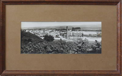 A black and white photograph taken from the hill t...