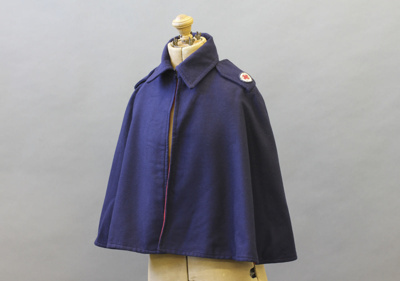 Cape; a navy blue wool Red Cross uniform cape with...
