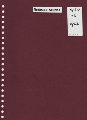 A maroon spiral bound album with photographs and r...