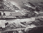 Photograph [1978 Flood, aerial view south end of Mataura Freezing Works & Paper Mill].; Henderson, Keith Raymond; 1973; MT2017.18.13
