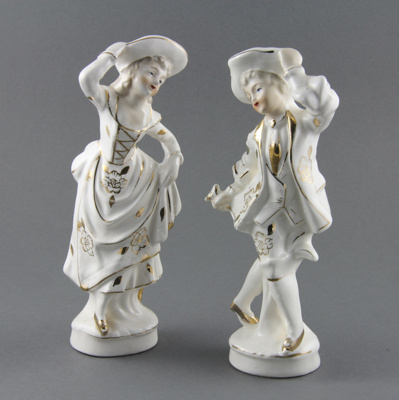 Ornament; a pair of china figurines depicting a yo...