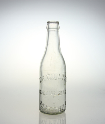 Bottle; a clear glass bottle used by T. F. Quilter...