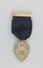 Medal, awarded to W.H. Russell at the 1932 Otago District Brass Band Competition ; unknown maker; 1932; MT2014.13.2