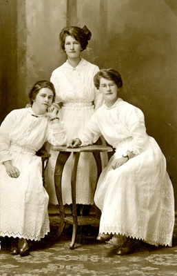 A black and white studio portrait of ( L to R) Ede...