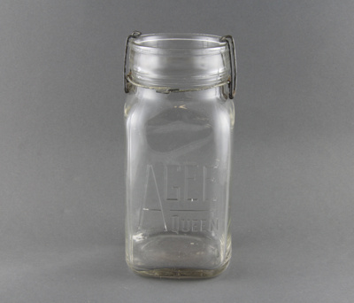 A clear glass jar, used for bottling preserves. Th...