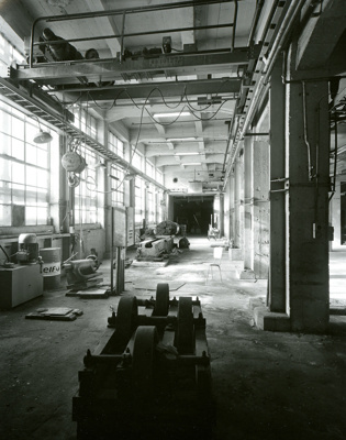 Black and white photograph of a workshop at the de...