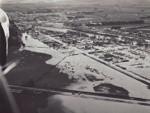Photograph [1978 Flood, aerial view north end of Mataura]; Henderson, Keith Raymond; 1973; MT2017.18.14