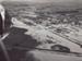 Photograph [1978 Flood, aerial view north end of Mataura]; Henderson, Keith Raymond; 1973; MT2017.18.14
