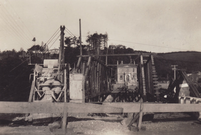 A black and white photograph showing the construct...
