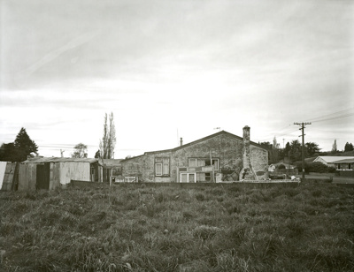 Black and white photograph, corner of Kana and Cly...