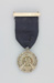 Medal, awarded to W.H. Russell at the 1935 New Zealand Brass Band Contest in Timaru ; unknown maker; 1932; MT2014.13.3