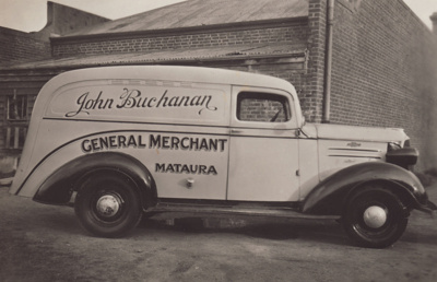A black and white photograph of the delivery van f...