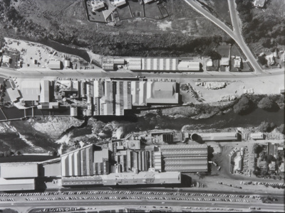 Photograph, framed [Mataura Paper Mill and Mataura Freezing Works aerial view]; unknown photographer; 1965-1975; MT2012.15.25