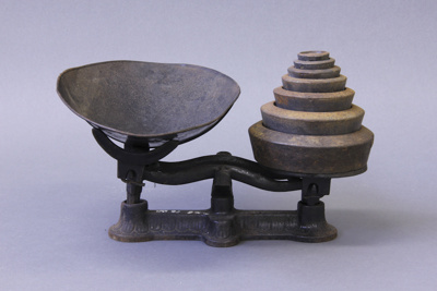 Scales; a set of cast iron kitchen scales.There ar...