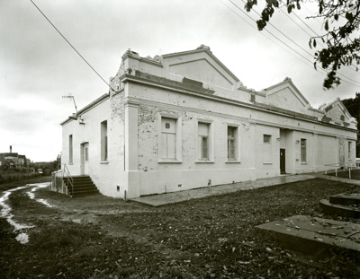 Black and white photograph of the vacant MacGibbon...
