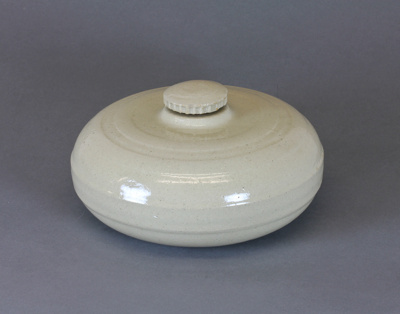 Hot water bottle; a round ceramic hot water bottle...