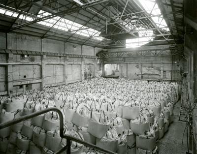 Black and white photograph of fertiliser premix st...