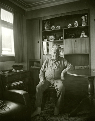 Black and white portrait of Stan White at home in ...