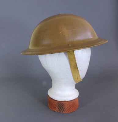 Helmet; a tin World War Two army helmet, with leat...