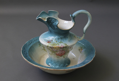 Ewer and basin set; glazed white and blue and deco...