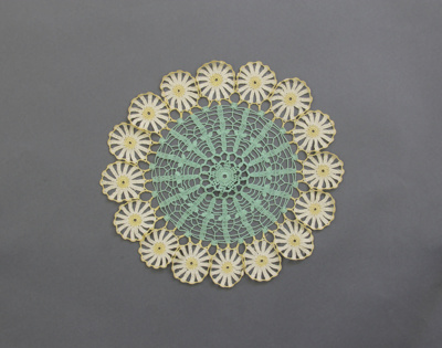 Table centre; circular crocheted table centre, gre...