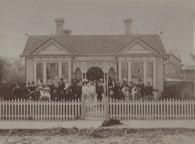 Photograph [Large Wedding Party Outside House]; Mitchell photo; 1910s; MT2011.185.244