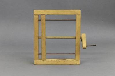 Bandage Winder; a wooden-framed bandage winder wit...