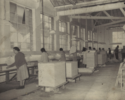 Photograph [Mataura Paper Mill employees stacking paper]; unknown photographer; 1962 c; MT2012.15.3