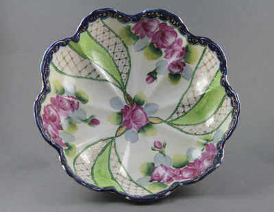 Fruit Bowl; with a floral pattern and a scalloped ...
