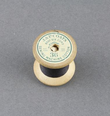 Sewing thread on spool, black cotton; 1950-1960; MT2012.105.6