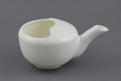 Pap boat; a white pottery pap boat, used for feedi...