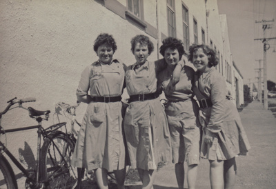 A black and white photograph of four girls who wor...