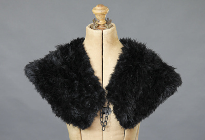 Cape; a lady's black feather shoulder cape with a ...