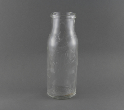 A clear glass bottle, used for bottling preserves....